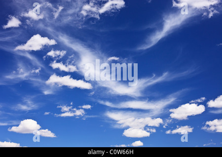Some scattered and wispy clouds in blue sky over rural western Oklahoma. - Stock Photo