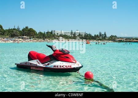 Jetski rescue in shallow water at the beach Nissi Beach, Ayia Napa, Cyprus, Europe, Mediterranean - Stock Photo
