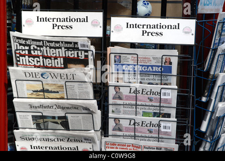 A selection of German and French newspapers on sale outside a newsagents shop in the High Street in Edinburgh's - Stock Photo