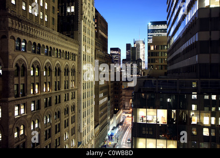 Closeup to office buildings at sunset time in midtown Manhattan, New York - Stock Photo