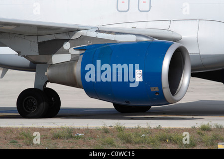 Close-up of a CFM56 turbofan jet engine on the wing of an Airbus A320, with CFM logo visible on the engine nacelle. - Stock Photo