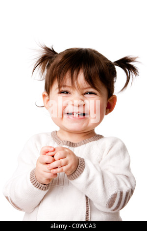 Beautiful expressive adorable happy cute laughing smiling baby infant toddler girl with ponytails showing teeth, - Stock Photo