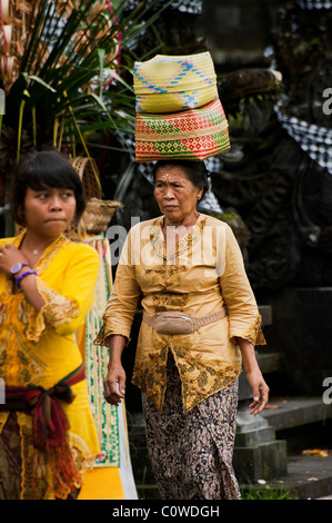 Hindu worshipers come to the most important temple in Bali, Indonesia-Besakih, or the Mother Temple to leave offerings - Stock Photo