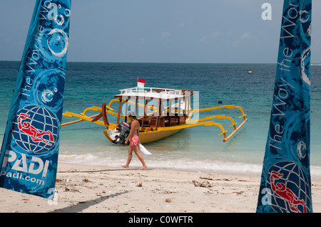 Glass bottomed dive boat on the beach at Gili Trawangan a small island off Lombok, Indonesia - Stock Photo