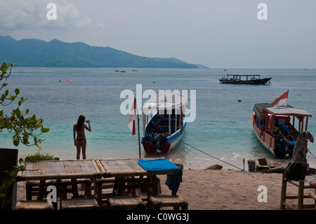 Beach at Gili Air the smallest island of the Gili group off Lombok Indonesia - Stock Photo