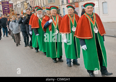 Procession in traditional garments of the vineyard brotherhoods during the traditional feast of the 'Saint-Vincent - Stock Photo