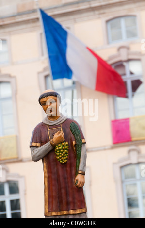 Statue of Saint Vincent during the procession of the 'Saint Vincent tournante' of Macon in 2009. The French flag - Stock Photo