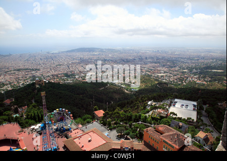 Wide-angle view of Barcelona and the Tibidabo theme park,  taken from the top of Temple de Sagrat Cor. - Stock Photo