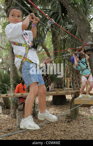Orlando Florida Sanford Central Florida Zoo & and Botanical Gardens ZOOm Air Adventure Park aerial treetop tree - Stock Photo