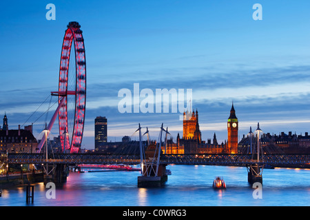 London skyline - views overlooking the River Thames toward The London Eye, the Houses Of Parliament and Jubilee - Stock Photo