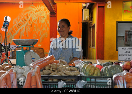 Woman selling organic vegetables at Victoria market in Victoria, Mahé Island, Seychelles - Stock Photo