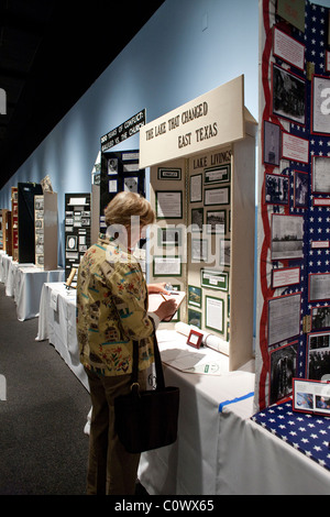 Male and female judges evaluate displays during Texas History Day competition at the Bob Bullock State History Museum - Stock Photo