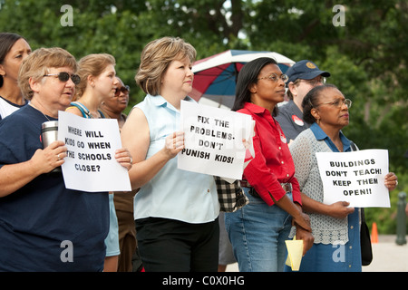 Parents of public school students protest proposed school closures due to students' poor progress on standardized - Stock Photo