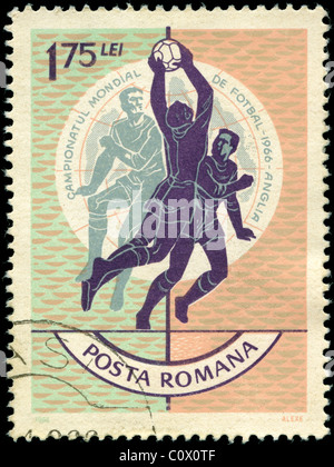 Stamp from Romania depicting football - Stock Photo