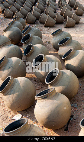 Hand made indian water pots drying in the sun before firing. Andhra Pradesh , india - Stock Photo