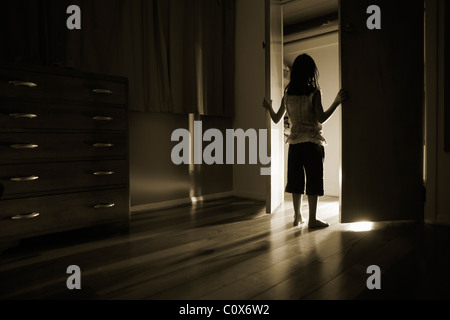 Light shines out from cupboard doors - Stock Photo