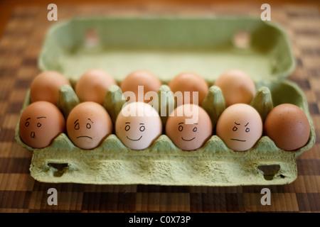Organic free range eggs in green egg box. - Stock Photo