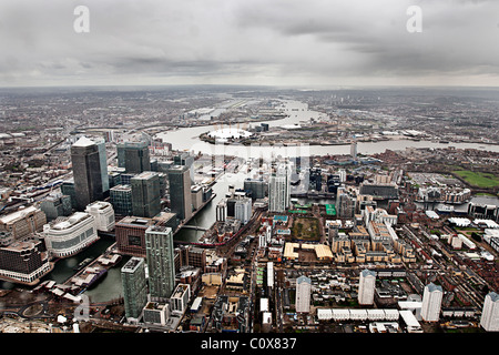 Aerial Shot of the Canary Wharf Estate on a Gloomy Day. Views over to the o2 Arena on the Greenwich Peninsula behind - Stock Photo