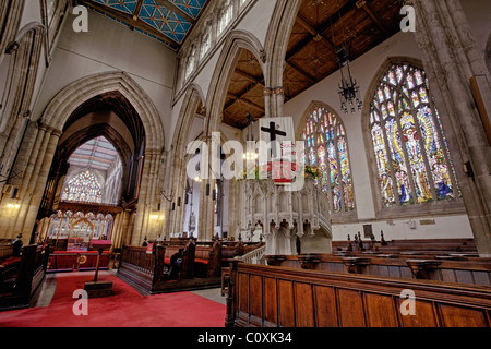 The Nave with the Chancel on the left and Pulpit ahead. Holy Trinity Church, Hull, East Yorkshire. - Stock Photo