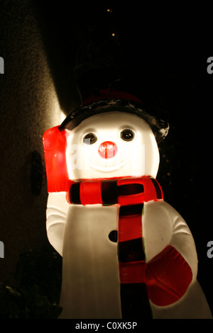 plastic snowman illuminated at night - Stock Photo