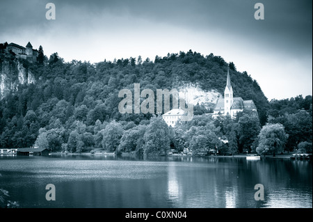 Lake and church. Bled, Slovenia, popular touristic destination. Toned black and white monochrome image with grain. - Stock Photo
