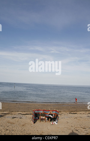 couple on the beach in llandudno wales great britain uk - Stock Photo