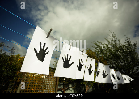 Hands on washing line. - Stock Photo