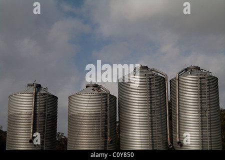 Feed silos outside broiler chicken poultry farm in Terceira island in the Azores - Stock Photo