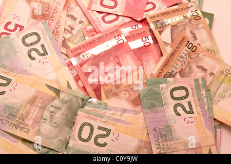 A lot of twenty, fifty and hunder Canadian dollar bills scattered - Stock Photo