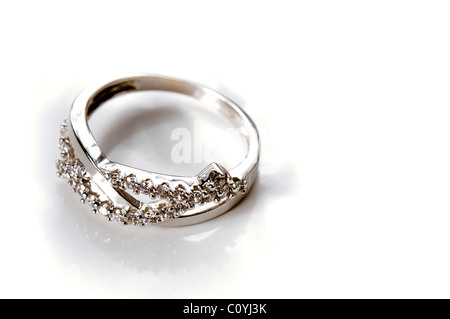White Gold engagement Ring with several diamonds - Stock Photo