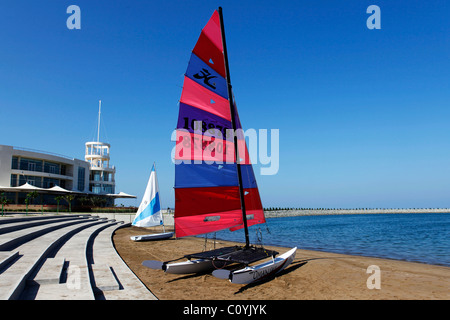 A Hobie 16 Class Catamaran on the beach at the Millennium Hotel at Mussanah, Oman. - Stock Photo
