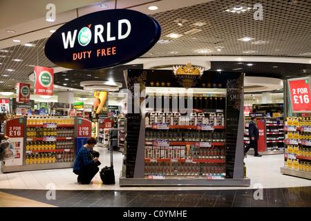 'World Duty Free' shopping area / shop / shops in the departure lounge of Heathrow airport, Terminal 3 / three. - Stock Photo