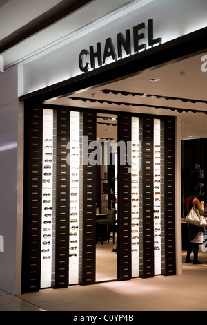 Luxury / Chanel optician / eye glasses / sunglasses / sun glasses shop / outlet in departure lounge at London Heathrow - Stock Photo