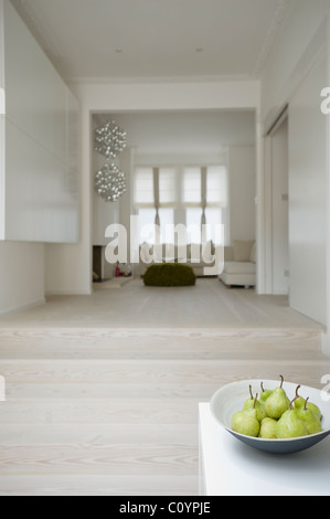 Open Plan Living Area On Split Level With Pale Wood Floors Stock
