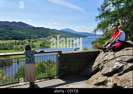 Tourists looking over Loch Tummel from Queen´s View near Pitlochry in Perth and Kinross, Scotland, UK - Stock Photo