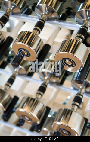 Metal weights in gym of luxury London hotel - Stock Photo