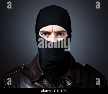 closeup portrait of caucasian criminal with balaclava - Stock Photo