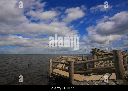 wooden platform at the lake with friendly cloudy sky - Stock Photo
