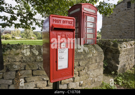 Street furniture - red post box & iconic historic K6 telephone box by drystone wall in scenic rural village - Leathley, - Stock Photo