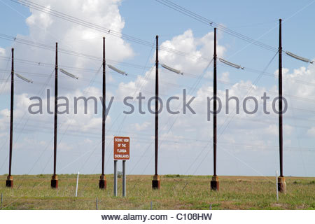 Florida The Everglades Alligator Alley sign scenic view utility poles lines wires visual pollution ugly - Stock Photo
