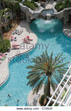 Sarasota Florida Hyatt Regency hotel swimming pool aerial overhead bird's eye view above from balcony palm trees - Stock Photo