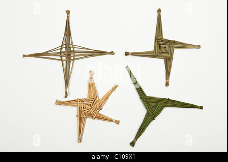 Versions of St Brigid's cross made of woven rushes, traditionally hung in Irish houses to protect the household - Stock Photo