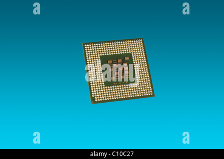 A computer Cpu on a blue background - Stock Photo