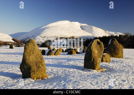 Snow covered Blencathra and Castlerigg Stone Circle in winter in the English Lake District - Stock Photo