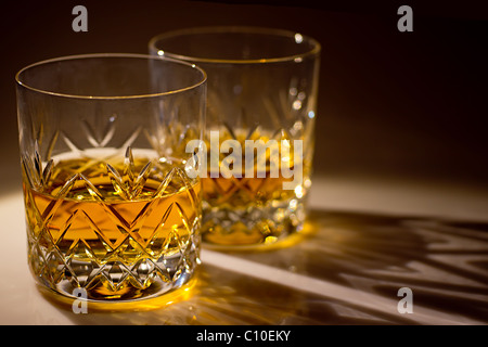 two cut glass whiskey glasses withe whiskey - Stock Photo