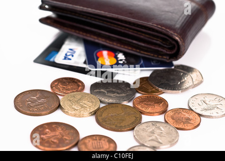 Empty wallet with credit cards- visa, mastercard, american express  and spilled pennies - Stock Photo