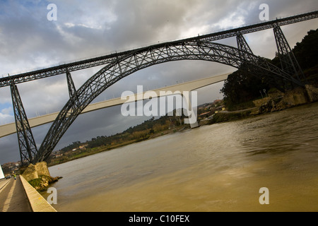 Dona Maria Pia Bridge by Gustav Eiffel 1877, was once longest iron arch in world, Douro River, Oporto, Portugal - Stock Photo
