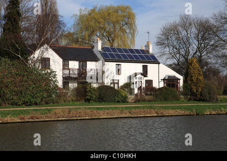 Solar panels on a period house near Cambridge, England, UK - Stock Photo