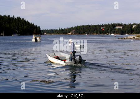 Man in dinghy, Isle au Haut, Arcadia National Park, Maine coast, New England, USA - Stock Photo