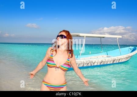 bikini medium age woman beach tourist in Caribbean tropical sea - Stock Photo
